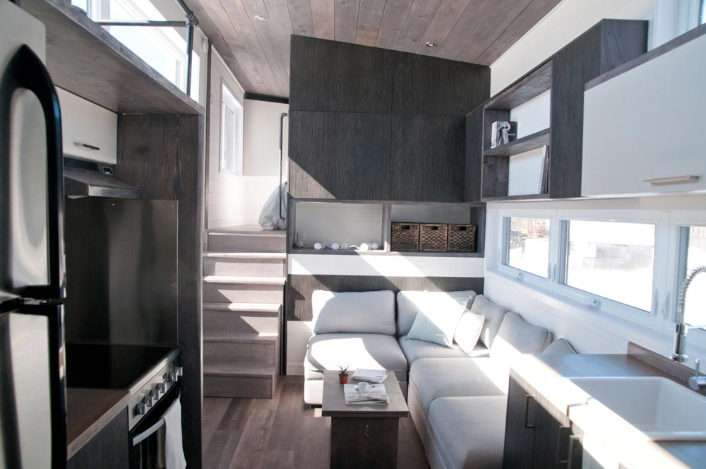 From Quebec, Canada-based Minimaliste is this beautiful 32′ gooseneck tiny house, the Sakura. The 10.5′ wide house totals 380-square-feet including the main floor and loft space.